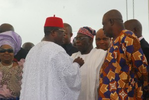 Governor David Umahi of Ebonyi State chatting with Former President, Olusegun Obasanjo (centre), during the burial of the mother of the governor in Uburu on Friday. With them are wife of former President Goodluck Jonathan, Patience; and former SGF, Sen. Anyim Pius Anyim. Photo: EBSG