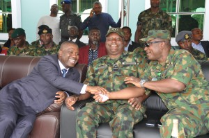 NDDC Managing Director, Mr. Nsima Ekere, (left), exchanging pleasantries with Air Vice Marshall, Stephen Onuh (right) and Rear Admiral Victor Adedipe (middle) of the Nigerian Navy during the Operationalization ceremony of the 6 Division of the Nigerian Army in Port Harcourt.
