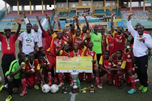 L-R: General Manager, Shell Nigeria, Igo Weli; Chairman, Lagos State Sports Commission, Deji Tinubu; Captain, Hensen Demonstration School Team, Osunde Nosakhare; and Public Affairs Supervisor, National Petroleum Investment Management Services, Bunmi Lawson, after presenting the NNPC/Shell Cup trophy to the winning team... on Tuesday.