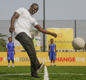 Akon plays football on the new pitch